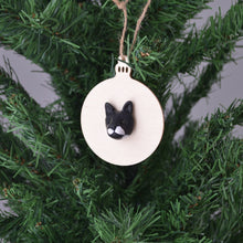 Bauble shaped christmas ornament with a handmade polymer clay cat face attached
