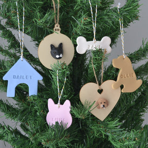 Handmade custom pet christmas ornaments hanging in a christmas tree.