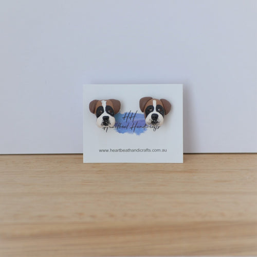 Custom dog earrings on white and timber background