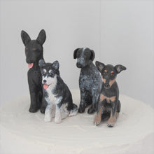 4 personalised dog cake toppers made from polymer clay
