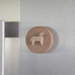 Timber bottle opener with handmade clay yellow lab sculpture attached displayed on fridge