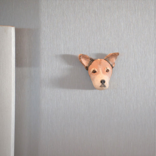 custom dog magnet displayed on fridge door