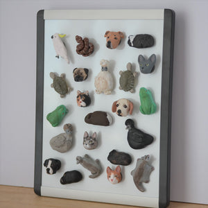 several different handmade clay animal fridge magnets