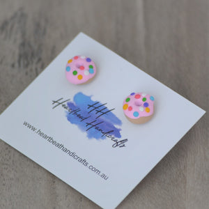 Close up details of pink donut stud earrings shown