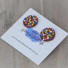 Close up details of chocolate freckle stud earrings shown