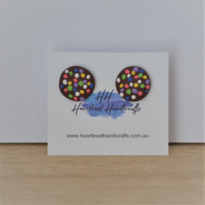 Chocolate freckle stud earrings shown on earrings card on timber and white background