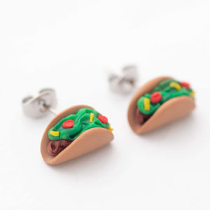 Taco stud earrings shown on up close