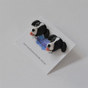 Handmade polymer clay border collie stud earrings shown close up
