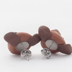Handmade polymer clay Staffy stud earrings showing surgical steel backs