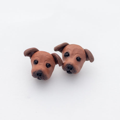 Handmade polymer clay Staffy stud earrings shown off card