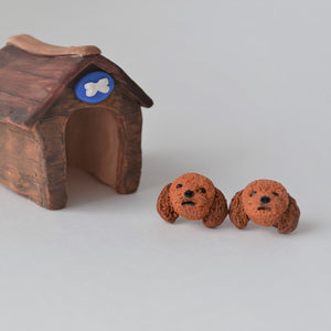 Handmade polymer clay Cavoodle stud earrings shown beside mini kennel