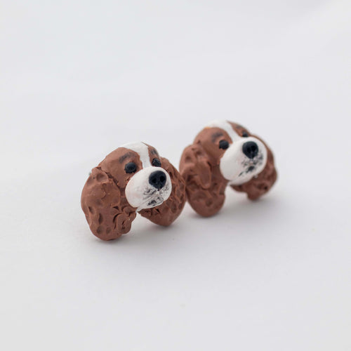 Handmade polymer clay cavalier king charles spaniel stud earrings shown on white background