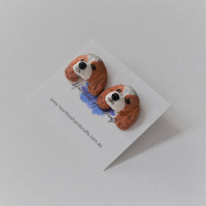 Handmade polymer clay Cavelier King Charles Spaniel stud earrings shown close up