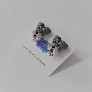 Handmade polymer clay schnauzer stud earrings shown close up