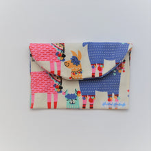 Cream with colourful llamas fabric handmade earrings travel pouch, pictured closed.