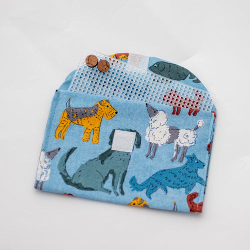 Blue dog handmade fabric earrings travel pouch displaying use