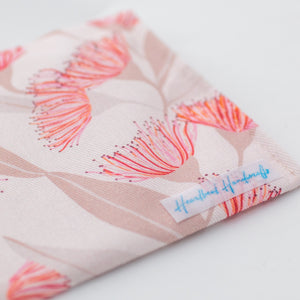 Flowering gums pink handmade fabric earrings travel pouch displaying back label