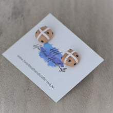 Close up details of hot cross bun stud earrings shown