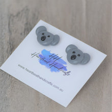 Close up details of koalas stud earrings shown