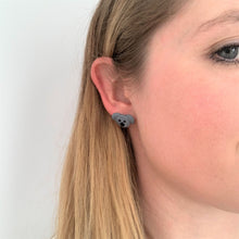 Koala stud earrings by Heartbeat Handicrafts being worn on model's ear