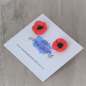 Close up details of poppies stud earrings shown
