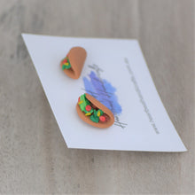 Close up details of tacos stud earrings shown