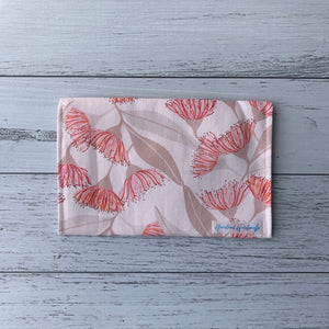Flowering gums pink handmade fabric earrings travel pouch displaying back