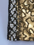 Vintage to antique metallic gold lamé leather heavily beaded evening bag