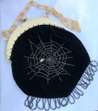 Late 1920s to 30s butterfly and spider hand beaded evening purse in black velvet on ivorine frame