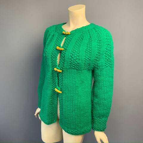 Vintage 1970s green cable detailed chunky knit cardigan with Bakelite toggles