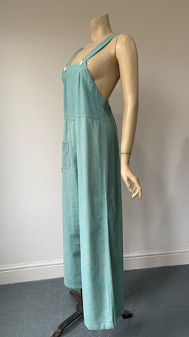 1920s / 1930s romper overalls or dungarees in turquoise linen with white piped trim