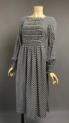 Beautifully made 1970s vintage honeycomb smocked autumn/winter day dress