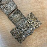 Victorian revival pressed filigree style metal belt with green glass foil backed cabochons