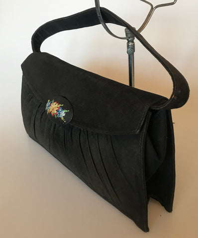 Vintage black suede purse with needlepoint clap and deco satin lining