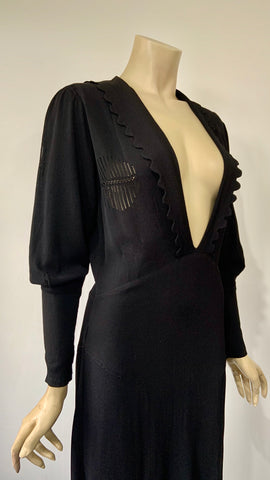 Art Deco vintage black rayon crepe plunge neck dress with oriental cut work detail and bishop's sleeves