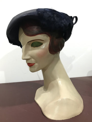 C.1940s asymmetric navy blue hat with feather trim