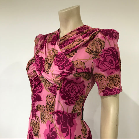 Wounded but still wearable - pink 1940s bold flower print dress