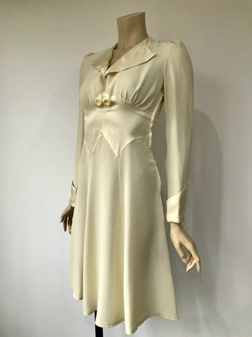 vintage 1970s ivory crepe Paul poly boutique style dress with satin detail