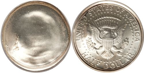 Kennedy Half Dollar Error Coin. The obverse features a blank coin with no design. The reverse features a typical Kennedy half dollar with an eagle holding arrows and an olive branch. The reverse reads: United States of America, Half Dollar