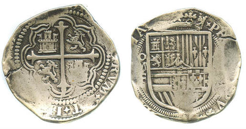 Spanish American Cob Coinage. Obverse features a cross. The Reverse features a shield.