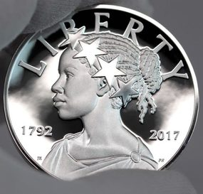 2017 Proof Silver American Liberty Coin Held by a hand in a glove