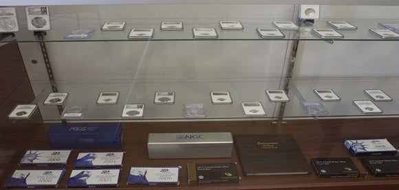 A showcase in our storefront that displays graded coins and proof sets.