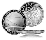 Proof Silver $1 Basketball hall of fame coin. The obverse shows 3 players, man, woman, & man in wheelchair going for a basketball. The reverse shows a basketball going through a hoop. The third image of the coin shows the coin on its side. It is curved so that the basketball is convex.