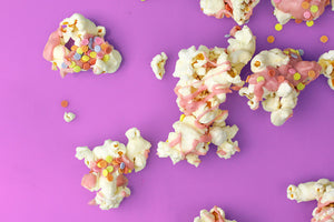 Homemade gourmet popcorn with chocolate and sugar decor