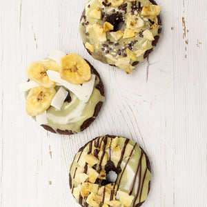 Chocolate cake donuts topped with banana flavored donut icing