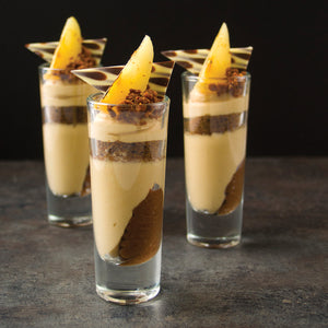 Layered parfait of caramel soaked sponge and pear flavored mousse