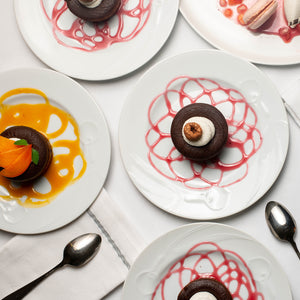Chocolate Lava Cakes plated with raspberry dessert sauce and mango dessert sauce