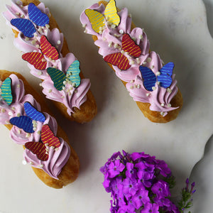 Butterfly Wings Assortment Chocolate Decor on frosted eclairs