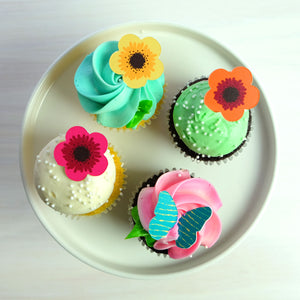 Tropical Flowers Assortment Chocolate Decor on colorful cupcakes