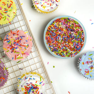 All natural rainbow sprinkles on cupcakes